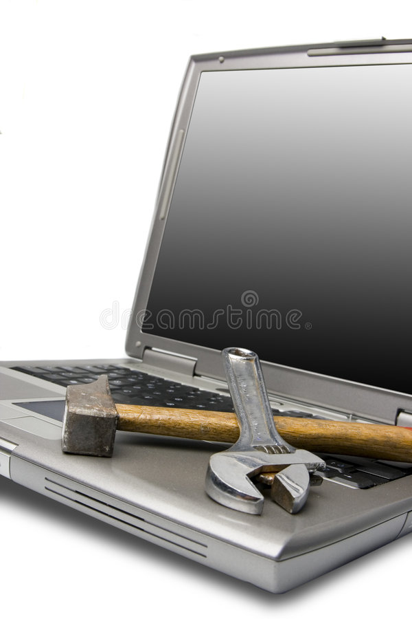 Laptop and tools royalty free stock photography