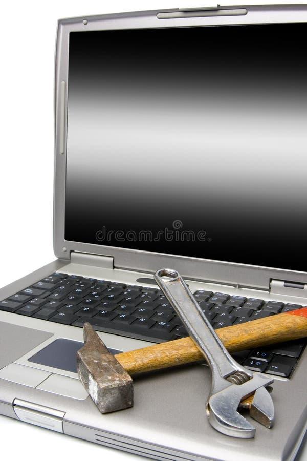 Laptop and tools stock photos