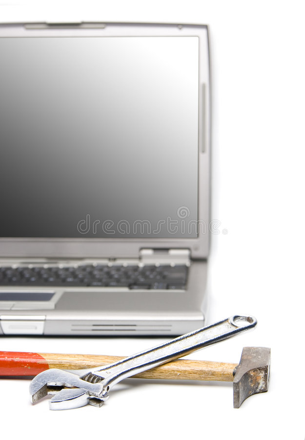 Laptop and tools royalty free stock image
