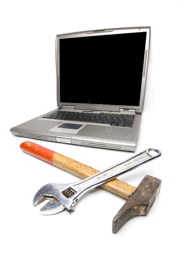 Laptop and tools royalty free stock photo