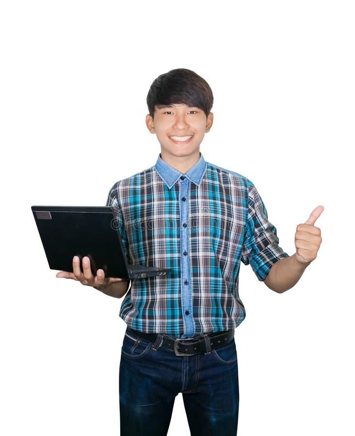 Laptop van de zakenman zekere jonge gebruikende computer en opgeheven handduim omhoog op witte achtergrond royalty-vrije stock foto's