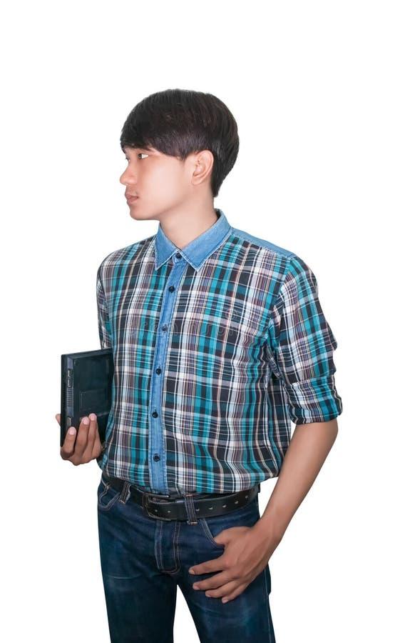 Laptop van de zakenman zekere jonge gebruikende computer en opgeheven handduim omhoog op witte achtergrond stock fotografie