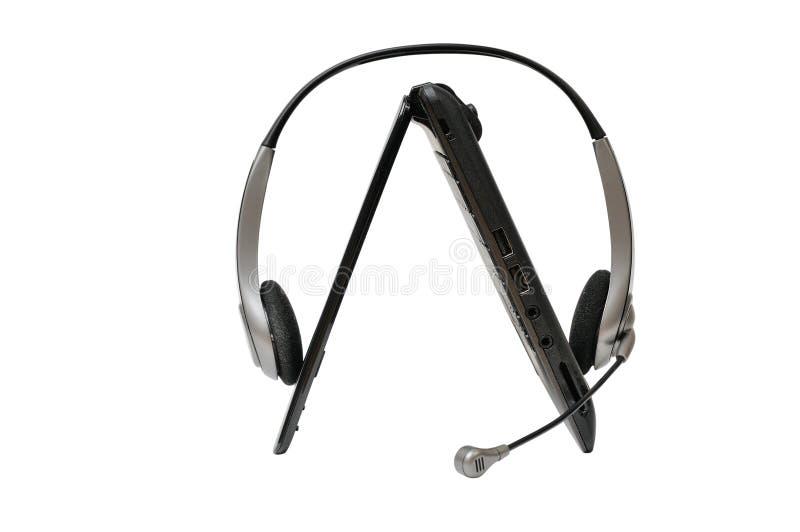 Laptop met stereohoofdtelefoon royalty-vrije stock afbeelding