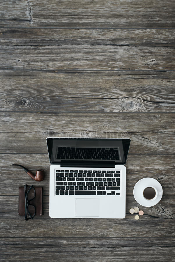 Laptop on a vintage desktop royalty free stock images