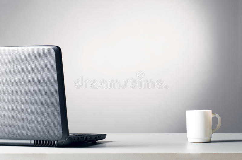 Download Laptop with white cup stock image. Image of notebook - 18455713