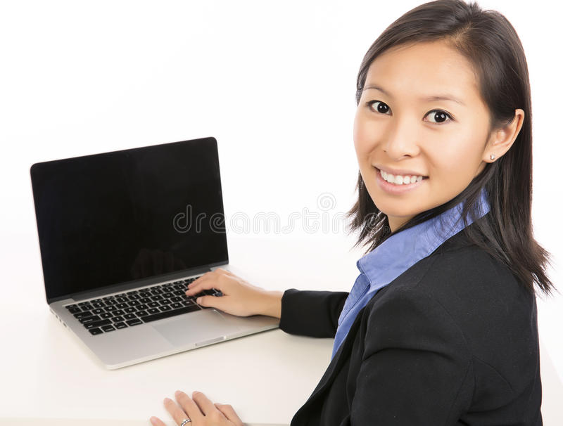 Laptop woman. Woman using laptop computer isolated on white background royalty free stock photo