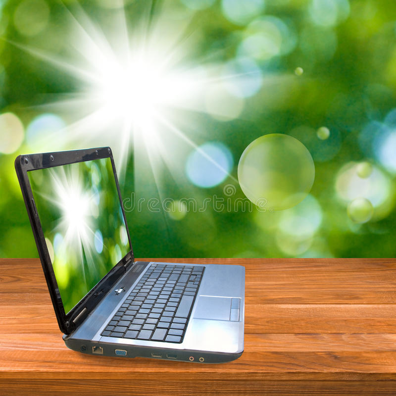 Laptop on a wooden board. royalty free stock images