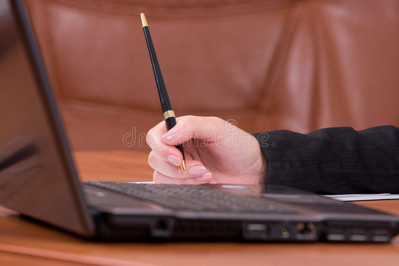 Laptop on a wooden brown table royalty free stock images