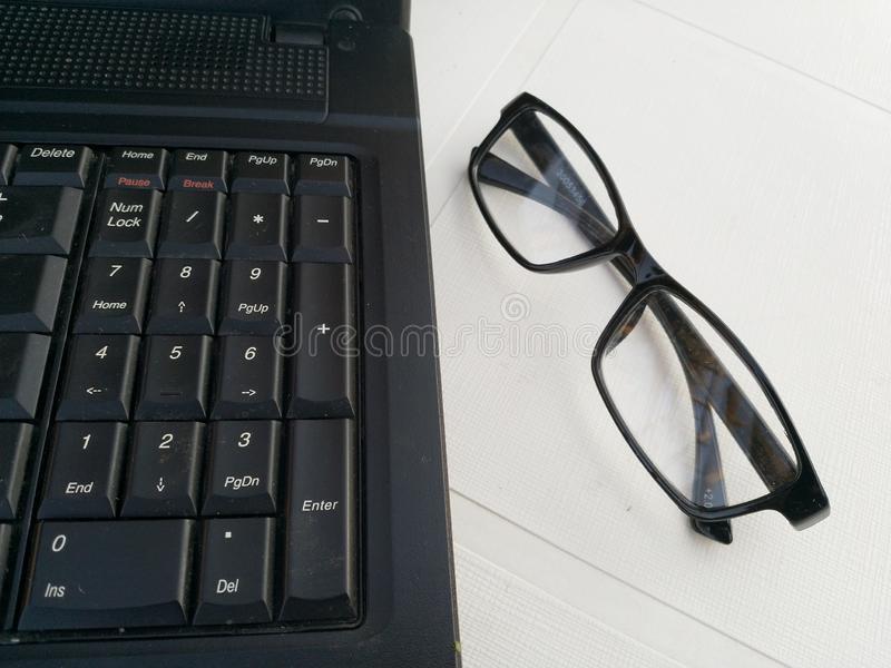 Laptop work station with specs royalty free stock image