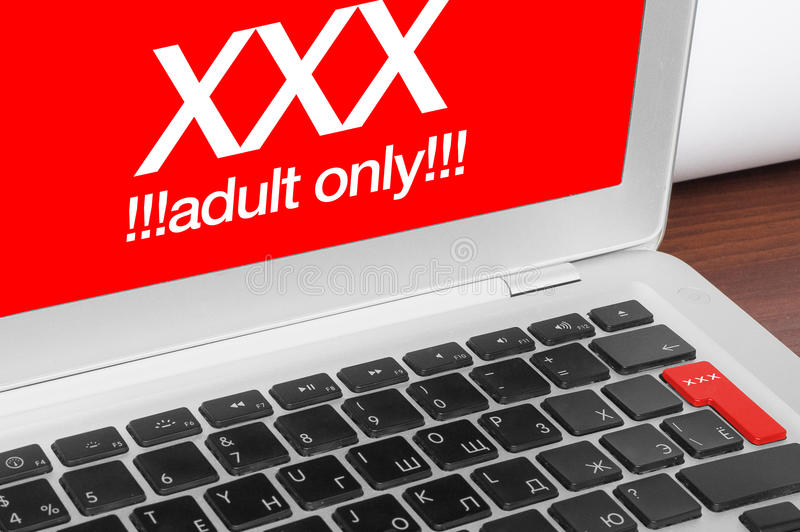Laptop with XXX message. Online concept. XXX adults only message on silver laptop and red xxx button on keyboard royalty free illustration