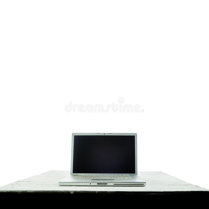 Laptopcomputer op witte houten textuurachtergrond Thuiswerk stock foto
