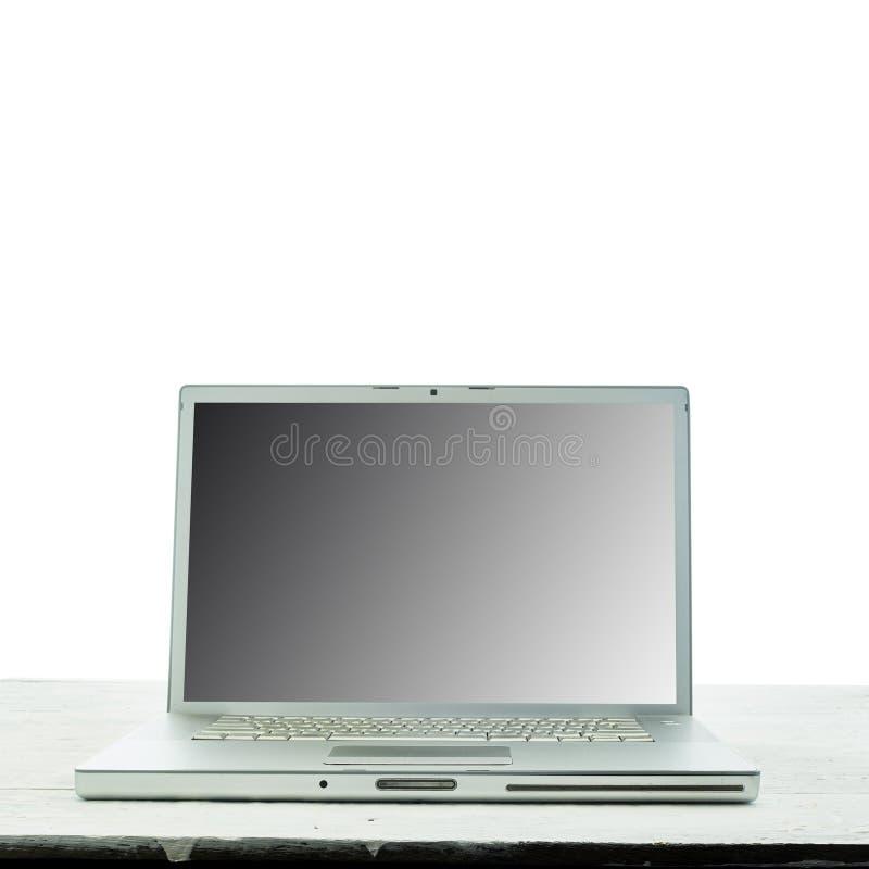 Laptopcomputer op witte houten textuurachtergrond Thuiswerk royalty-vrije stock afbeeldingen