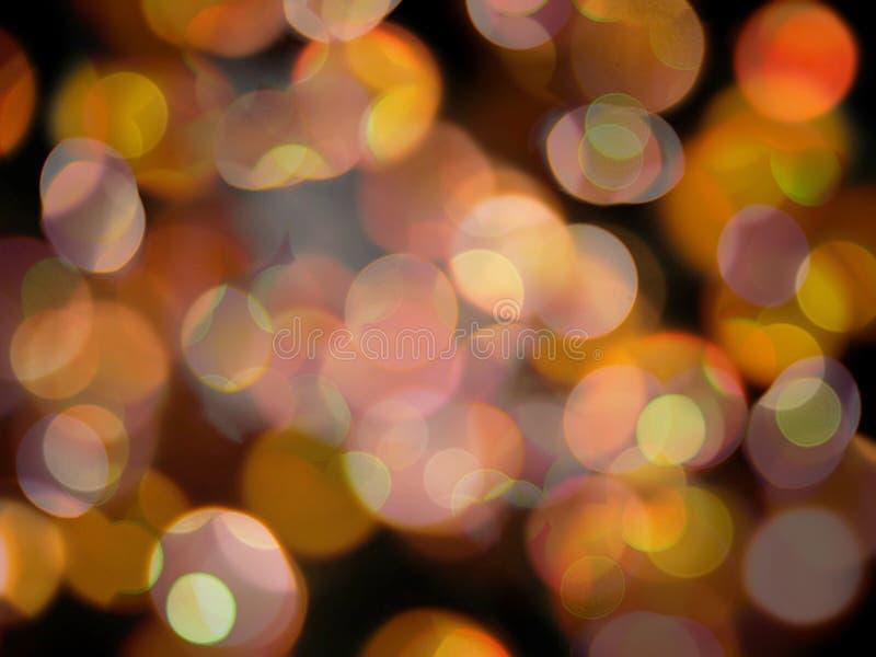 A laranja redonda de incandescência e o círculo de brilho branco borraram o fundo das luzes imagens de stock royalty free