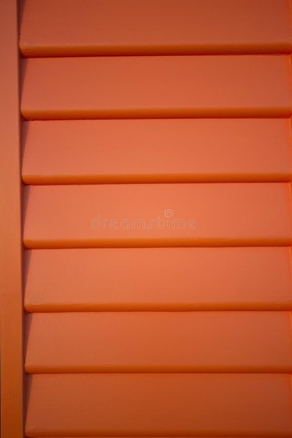 A laranja weatherboard linhas teste padrão do fundo imagem de stock royalty free