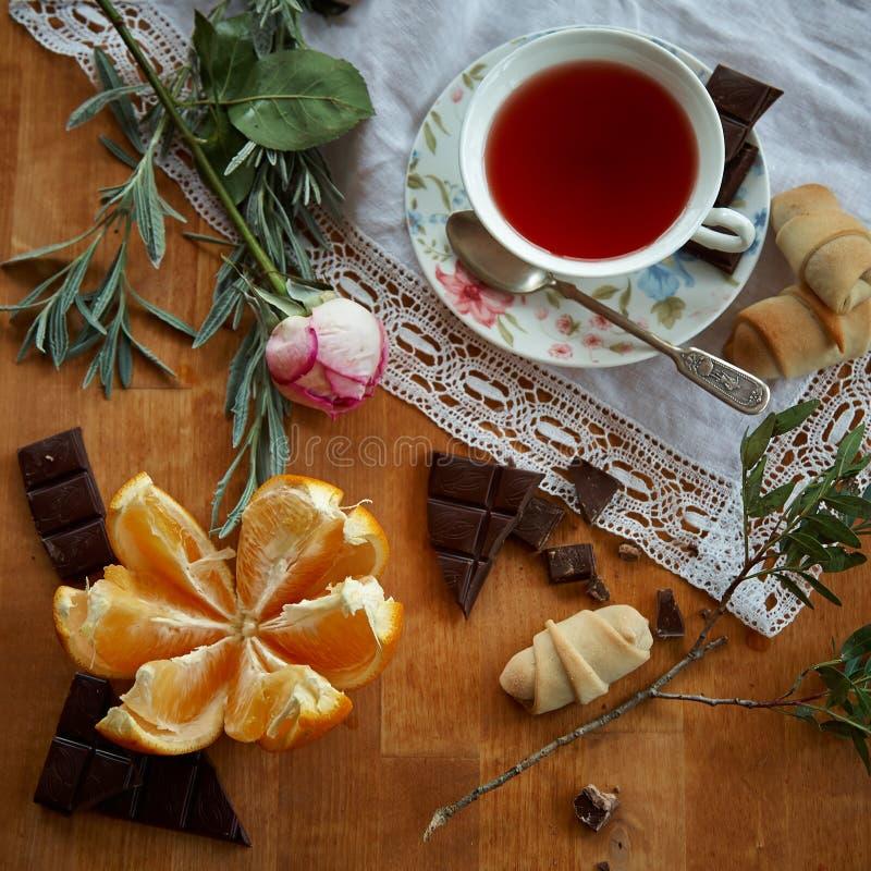 Laranjas do tempo do chá e chocolate 7 imagens de stock
