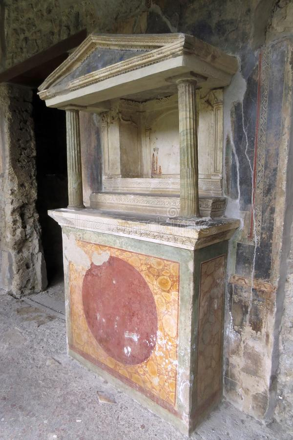Closeup of the well preserved Lararium of the House of the Golden Cupids in Pompeii, Italy, Europe stock photography