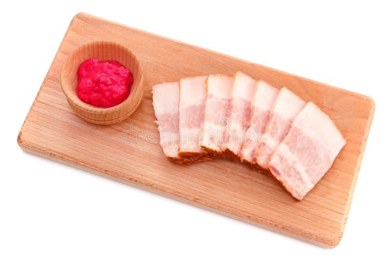 Lard de bajoue avec de la sauce à raifort images stock