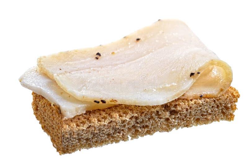 Lardo salato affumicato con il pane di segale e dell'aglio immagine stock