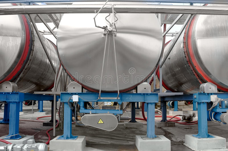 Large aluminum drums tanks and pipelines modern plant for the pr stock photo