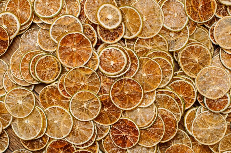 Large amount of fresh and tasty slices of lemon fruits. Large amount of neat, fresh and tasty slices of juicy lemon fruits arranged chaotically. Closeup stock photos