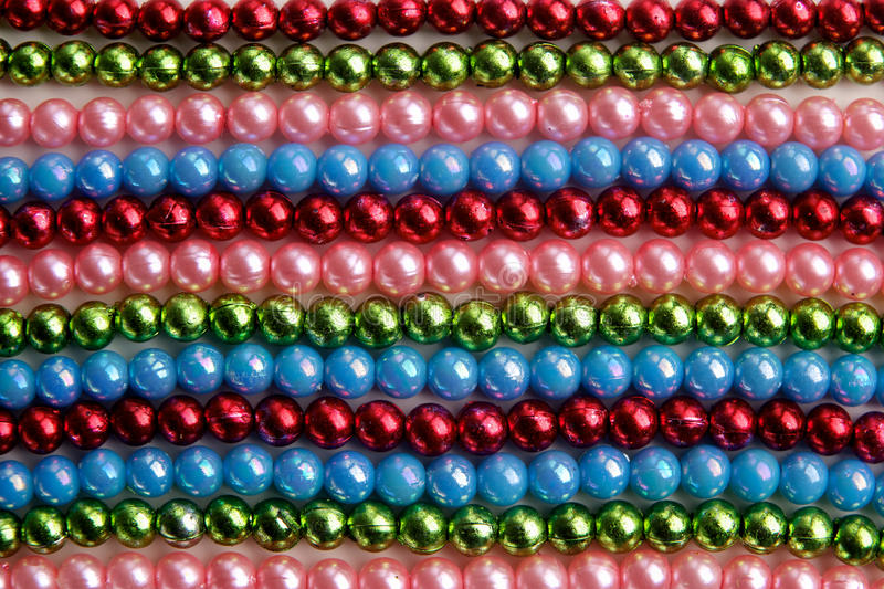 Large amount of madri gras bead background. Top view. Background of large amount of madri gras bead background stock photography