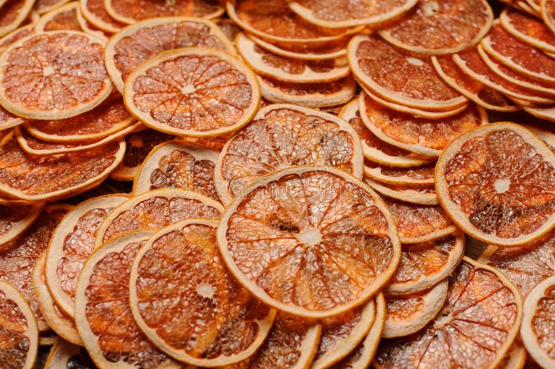 Large amount of fresh and tasty slices of orange fruits. Large amount of neat, fresh and tasty slices of juicy orange fruits arranged chaotically. Closeup stock photography