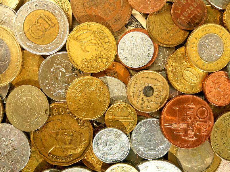 Large amount of old money coins of different countries on dollar background. Image of large amount of old money coins of different countries on dollar background royalty free stock photography