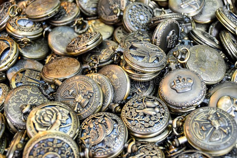 Large amount of similar pocket watches close together stock images