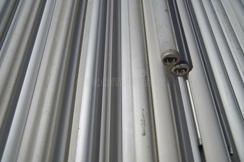 Large amount of spent old fluorescent lamp tubes about to be recycled. stock photo