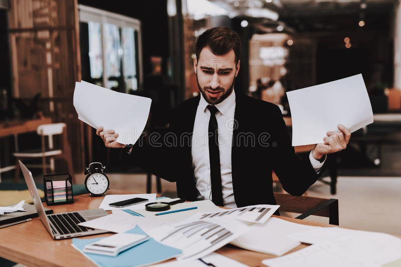 Large Amount of Work. Disappointed. Business Suit. Large Amount of Work Disappointed Business Suit Workplace Ideas Project Laptop. Sit Brainstorm Young Guy royalty free stock photography