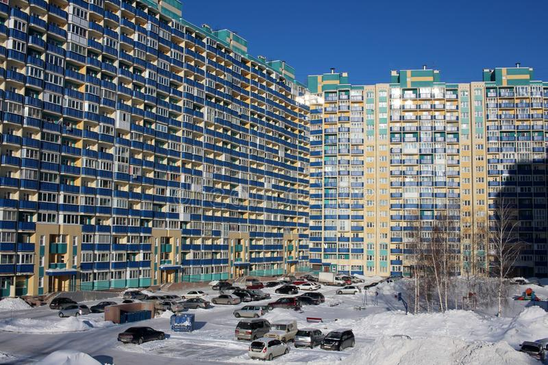 Large apartment building in the city high population density. Parking lack of space resources royalty free stock image