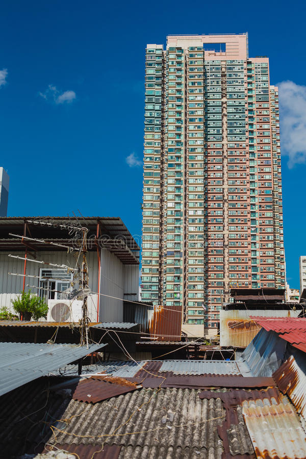 Skyscraper and metal rooftop apartments in Hong Kong stock images