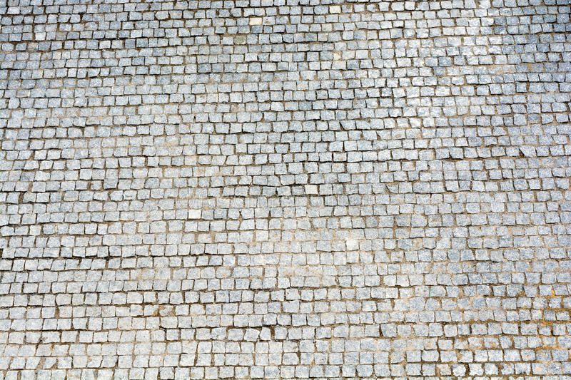 A large area, laid out of paving stone. Background texture royalty free stock images