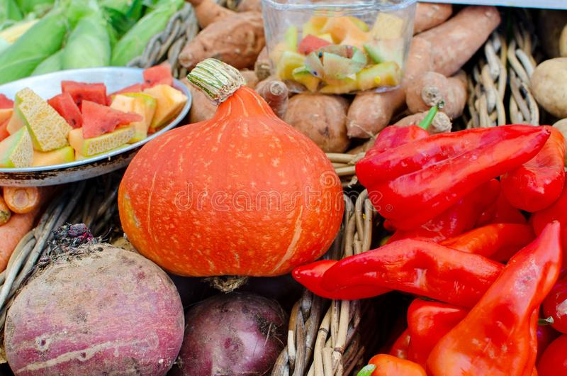 Large assortment of seasonal fruits and vegetables sold at farmers market royalty free stock images