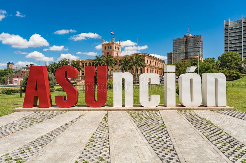 Asuncion letters in front of the Presidential Palace in the capital of Paraguay. Large `Asuncion` letters in front of the Presidential Palace in the capital of royalty free stock photo