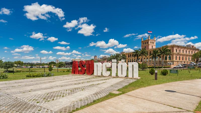 Asuncion letters in front of the Presidential Palace in the capital of Paraguay. Large `Asuncion` letters in front of the Presidential Palace in the capital of stock images