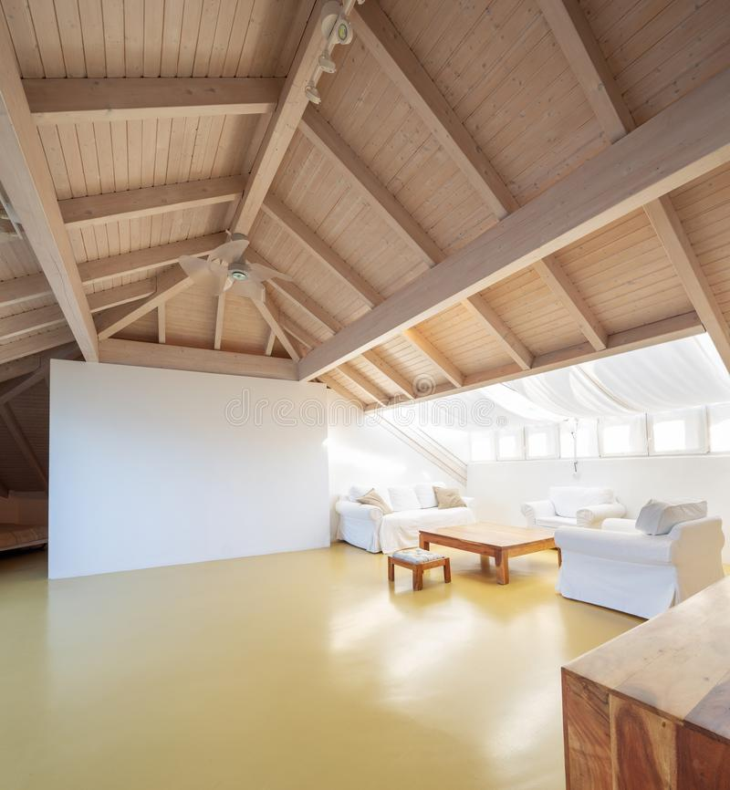 Large attic with wooden ceiling royalty free stock image