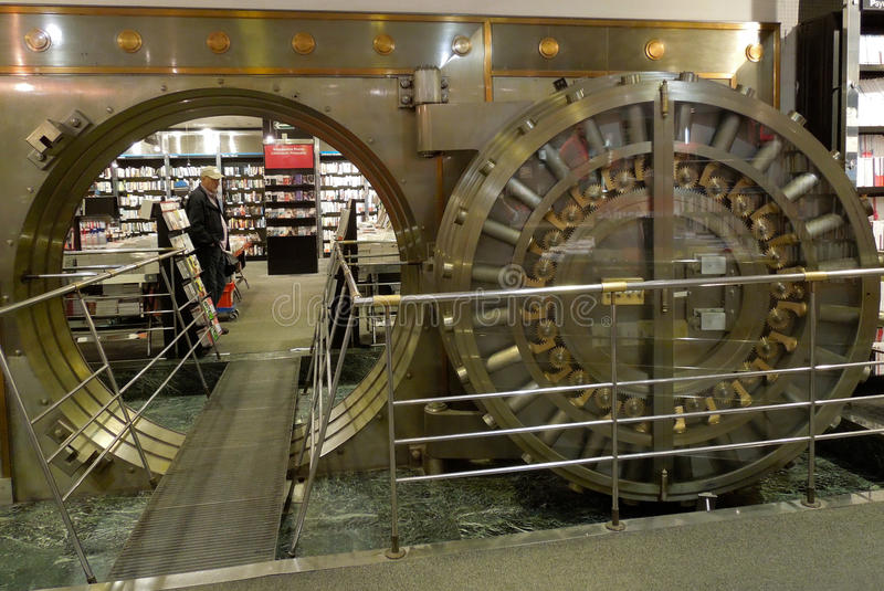 Large Bank Vault Door Opened in Bookstore royalty free stock images
