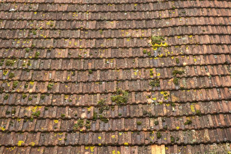 A large barn roof of rustic tiles. Full frame construction background texture details. A large barn roof of rustic French tiles. Full frame construction royalty free stock image