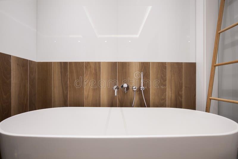 Large bathtub in stylish bathroom royalty free stock image