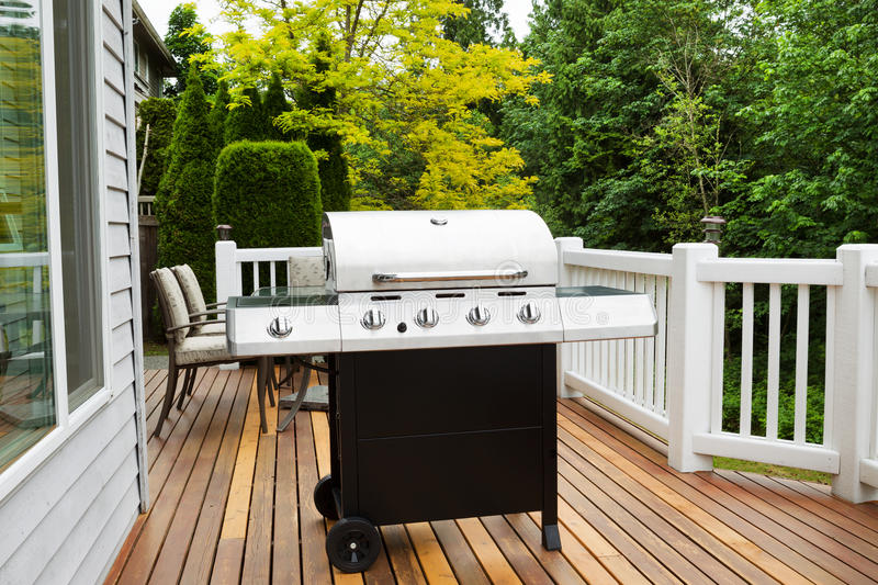 Large BBQ Grill on Wooden Deck stock photo