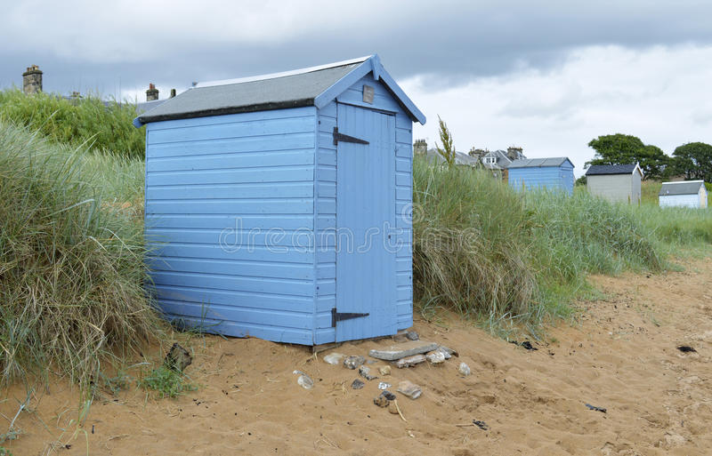 Large Beach Huts. Landscape view. Beach huts on a grass verge stock photography