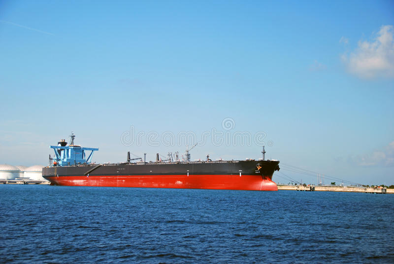 Large black tanker in Singapore anchorage. stock images