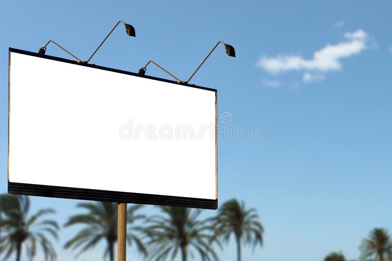 Large blank billboard mockup on summer blue sky and palm trees background stock photo