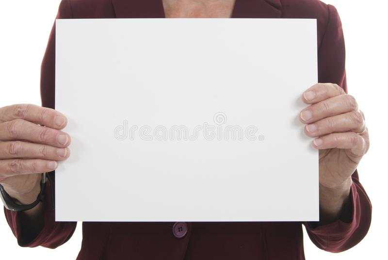 Large blank card held up by businesswoman royalty free stock images