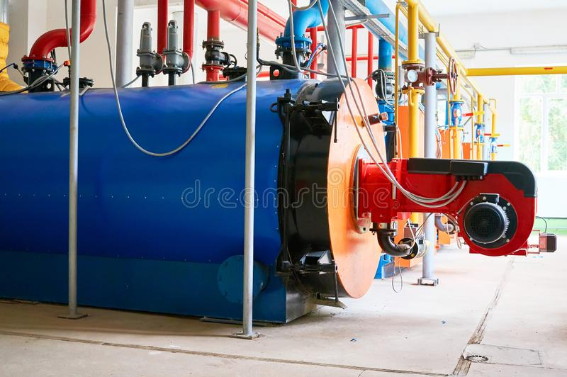 Large blue water boilers with a red-colored gas burner. stock image