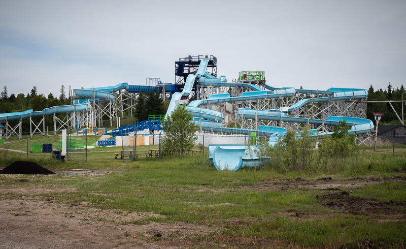 Large blue water slide under repair in the summer time. royalty free stock image