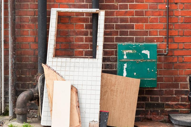 Large boards and waste items left at the corner of London street stock images