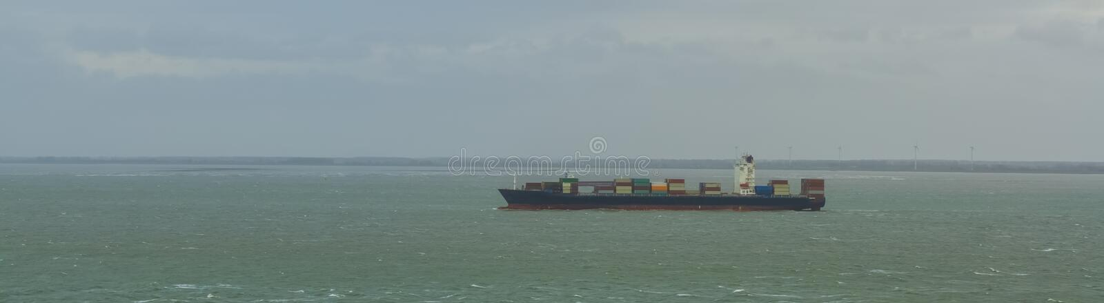 Large boat shipping sea containers, logistic cargo transport over sea. A large boat shipping sea containers, logistic cargo transport over sea stock photography