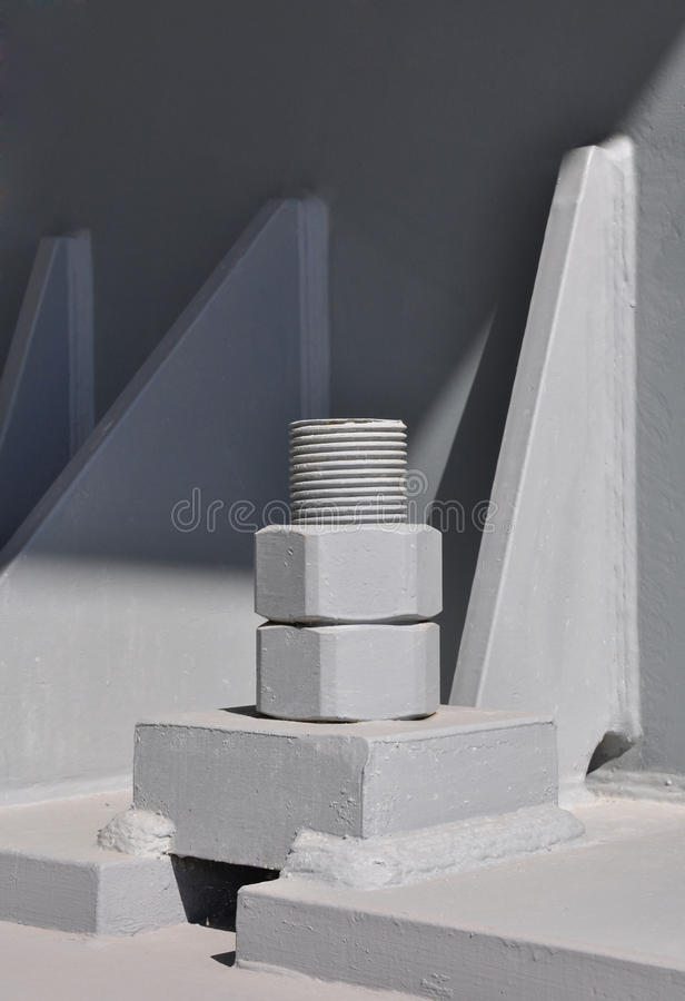 Large bolt and nut. Fixing steel to concrete base with a bolt and nut royalty free stock photos